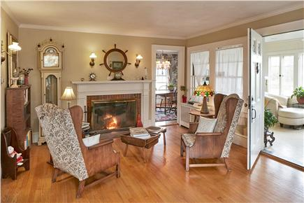 Falmouth Cape Cod vacation rental - Living room with fireplace, opens onto front porch