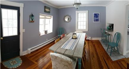 Harwich Cape Cod vacation rental - Dining room off kitchen with bar eating area
