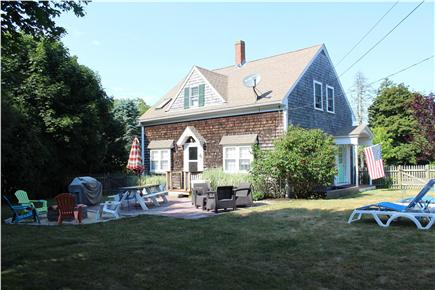 Harwich Cape Cod vacation rental - Back yard w/patio, fire pit, BBQ, hammock - private & fenced in