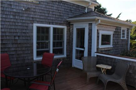 Harwich Cape Cod vacation rental - Entrance of house by driveway with deck and furniture