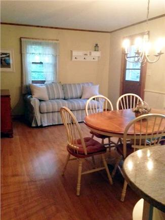 East Orleans Cape Cod vacation rental - Open kitchen with dining area and sofa