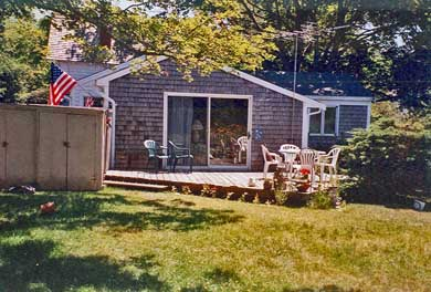 Barnstable Village Cape Cod vacation rental - Family Room Opens through Slider to Deck