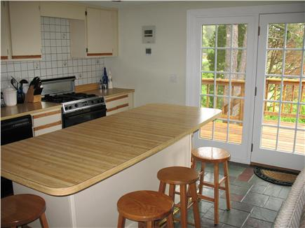 Mashpee Cape Cod vacation rental - Eat in kitchen looking out at entry deck