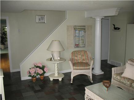 Mashpee Cape Cod vacation rental - TV room and bath on the right  to sunken living room on left