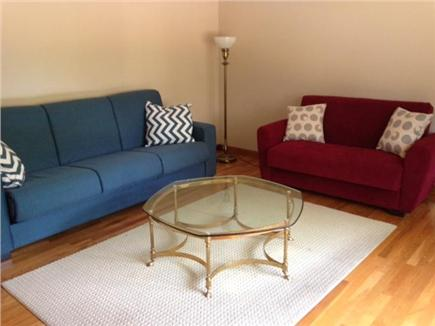 West Falmouth Village Cape Cod vacation rental - Living Room with fold down couch and chair.