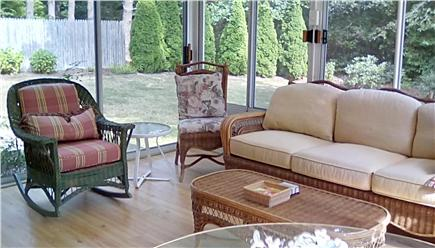 West Falmouth Village Cape Cod vacation rental - 4 season sun room with sliding doors and windows. Seats 8.