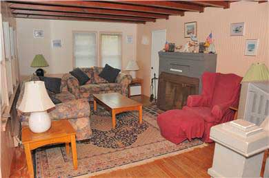 East Sandwich Beach.  Just off Cape Cod vacation rental - Living room with dune and ocean view and fireplace