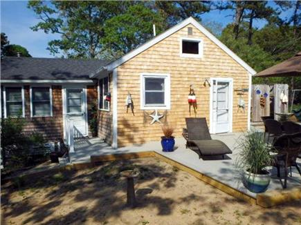 North Eastham Cape Cod vacation rental - Side view. of cottage with new  decking