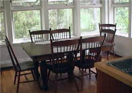 Wellfleet Cape Cod vacation rental - Kitchen Dining area with door to wooded kitchen deck.