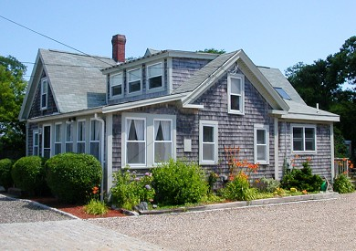 Dennis Port Cape Cod vacation rental - Side view. Private 50-ft backyard out back.