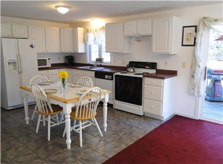 South Yarmouth Cape Cod vacation rental - Kitchen area with dining table