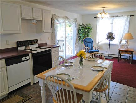South Yarmouth Cape Cod vacation rental - Kitchen area adjacent to living room, slider to deck