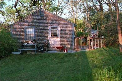 North Eastham Cape Cod vacation rental - Side view of deck, gas grill