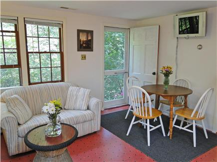 North Eastham Cape Cod vacation rental - Dining table, TV on wall