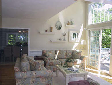 Brewster Cape Cod vacation rental - Living room opens to deck with lake views