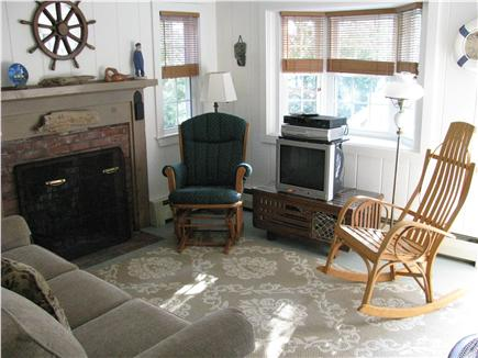 West Dennis Cape Cod vacation rental - Comfortable living room with direct deck access