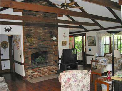 Chatham Cape Cod vacation rental - Spacious living area with beamed ceilings & fireplace