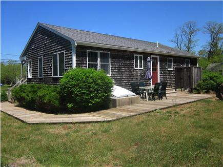 Eastham Cape Cod vacation rental - Back of house with deck and enclosed outside shower