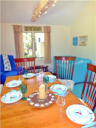 North Eastham - Bayside Cape Cod vacation rental - Dining area with bench seating for crowds! Reading nook is nearby
