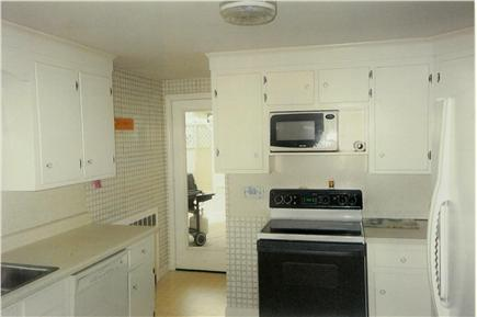 Hyannis Cape Cod vacation rental - Kitchen leading to large deck and Jacuzzi