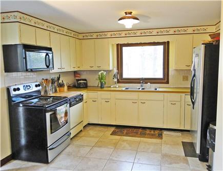 So. Harwich/So. Chatham Cape Cod vacation rental - Dining room opens to kitchen (new stove, fridge, and microwave)