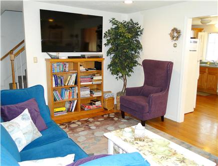 Dennis Cape Cod vacation rental - Living room TV, opens to kitchen and dining areas