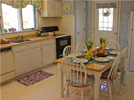 Chatham, Ridgevale Beach Cape Cod vacation rental - Fully equiped kitchen with dining area and door to deck