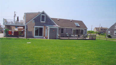 West Dennis Cape Cod vacation rental - Back of house showing yard & decks