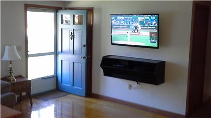 South Dennis Cape Cod vacation rental - Living room with entertainment center.
