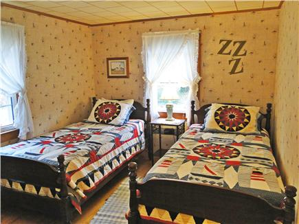 South Chatham Cape Cod vacation rental - Twin bedroom with antique beds and bureau