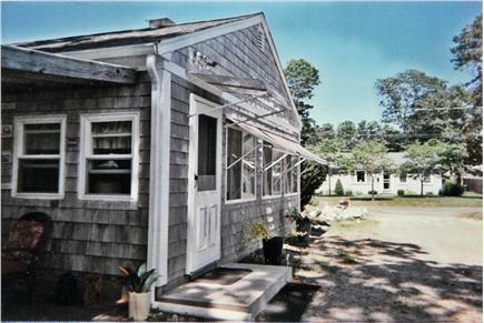 South Yarmouth/Bass River Cape Cod vacation rental - Side entrance, roll up awnings & driveway
