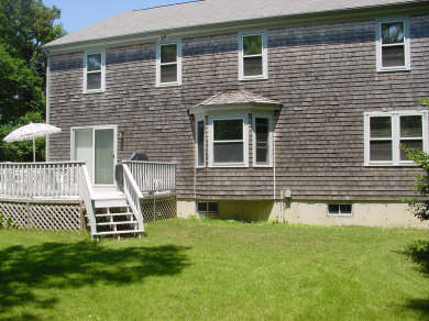 Hyannis Cape Cod vacation rental - Great  outside view of rear lawn, deck, & house