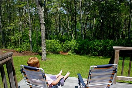 Harwich Cape Cod vacation rental - Enjoy the deck and the view through woods towards Sand Pond.