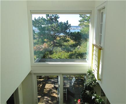 Wellfleet 4 acres on the inner Cape Cod vacation rental - Upper View of Atrium   French Door Opening to Master BedRoom