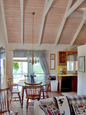 Eastham Cape Cod vacation rental - View to Dining Area and Screened Porch, wood floors throughout
