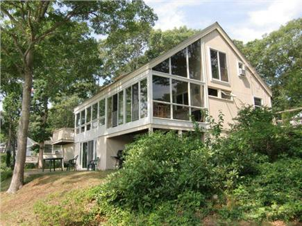 Hyannis Cape Cod vacation rental - WaterSide View showing Basement Doors, Lower Patio and Upper Deck