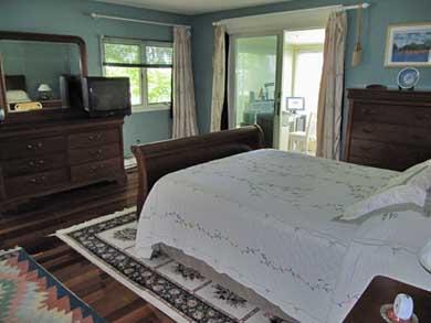 Plymouth, Manomet MA vacation rental - Upstairs MBR opens to study area in enclosed porch w/water views
