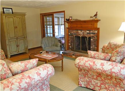 Harwichport Cape Cod vacation rental - Bright living room with fireplace, two sofas,chair