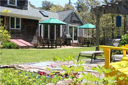 Brewster, The Highlands Cape Cod vacation rental - Well- landscaped backyard with privacy fencing