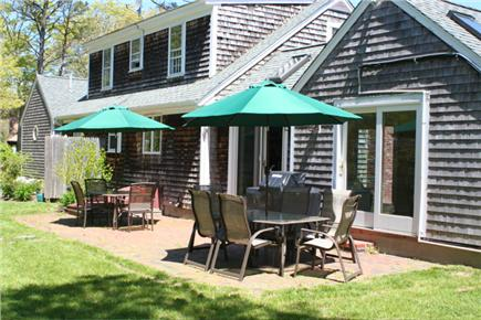 Brewster, The Highlands Cape Cod vacation rental - Dining for 12 outside with gas grill and yard games