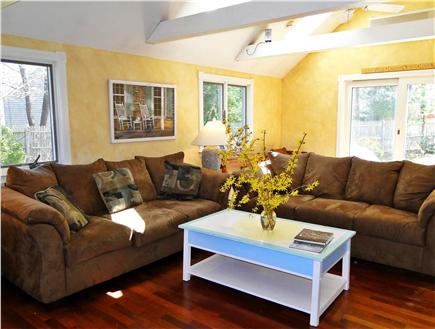 Brewster, The Highlands Cape Cod vacation rental - Bright, lofted living area with slider to back patio