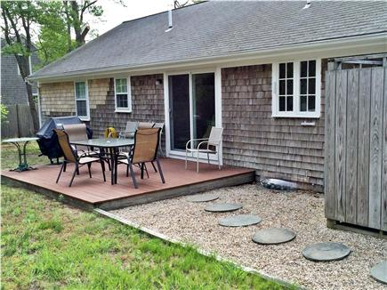East Harwich, Pleasant Bay Cape Cod vacation rental - Deck with grill and walkway to outdoor shower
