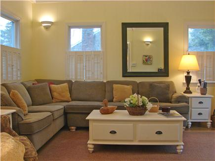 East Falmouth Cape Cod vacation rental - Family room adjacent to kitchen with TV, DVD and slider to deck