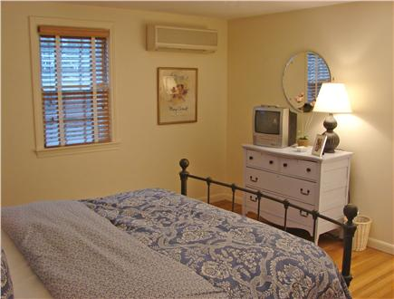 East Falmouth Cape Cod vacation rental - Upstairs large queen bedroom with wood floors and ceiling fan