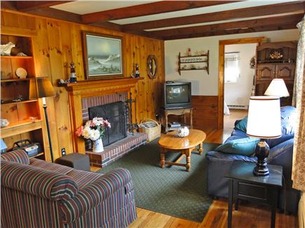 Dennis Cape Cod vacation rental - Bright living room with fireplace, harwood floors