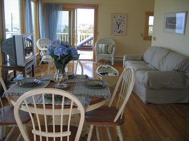 South Wellfleet Cape Cod vacation rental - Open living/dining with sliders to deck offers water view