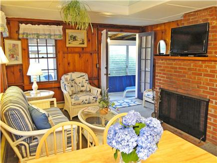 Harwich Port at Bank St. Beach Cape Cod vacation rental - Sunny living room w/ new television, skylight & entry to porch