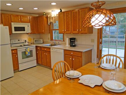 East Falmouth Cape Cod vacation rental - Kitchen and dining area, sliders to deck