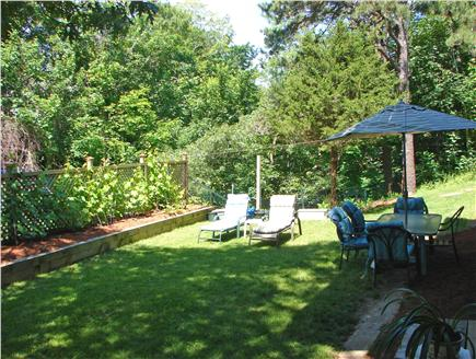 Wellfleet Cape Cod vacation rental - Back yard with dining area, lawn and gardens