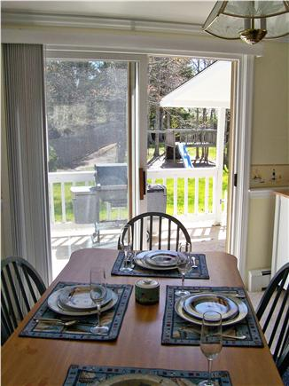 South Yarmouth Cape Cod vacation rental - Dining Room w/ slider to deck with grill & backyard w/play area